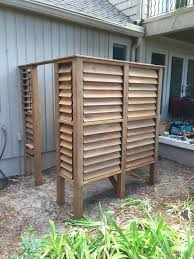 outdoor louvered shower by scott renov8ed homes