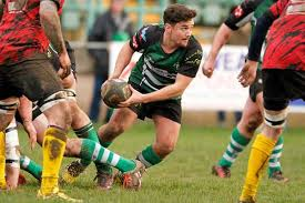 half century caerphilly scrum half jac jonathan uses the ball
