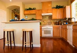 dark oak kitchen cabinets. This Traditional Home Has A Beautiful Backsplash And Wicker Bar Stools. The Dark Wooden Floor Oak Kitchen Cabinets