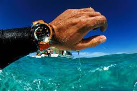 men s diving watches buying tips outwardon com orange and black diving watch on man s wrist in water