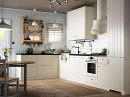 off white country kitchens. Simple Off An Offwhite Country Kitchen With Black Worktops Combined  Oven And Extractor Hood And Off White Country Kitchens T