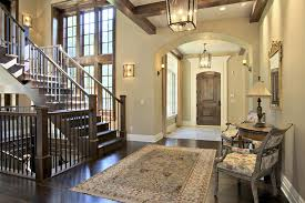 home entrance furniture. arched foyer entry to home with stairs and large area rug entrance furniture