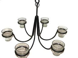 wrought iron chandeliers and hanging candle holders outdoor candle chandelier this hand wrought 6 arm votive candle chandelier is smaller than our other 6