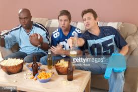 three men watching football in living room stock photo getty images three men watching football in living room stock photo