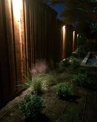 dallas landscape lighting installs wall lighting along fences walls or exteriors of homes buildings