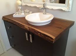 dark bathroom countertops made from laminate with white sink and a faucet
