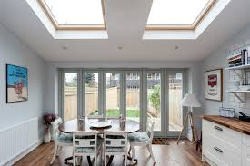 a single y extension was built to give liz and her family a large open plan kitchen diner the use of bi folding doors and skylights