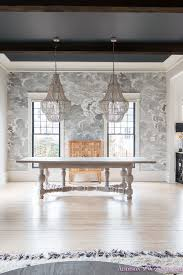 dining room wallpaper inkwell black ceiling nuvolette whitewashed hardwood floors ceiling beams two chandeliers cole and sons black window sashes gossamer
