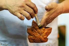 close up hand of thai sculptor during painting the masterpiece o stock photo image