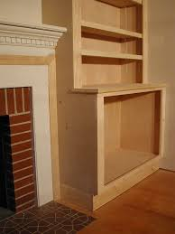 plans for building a book shelf around a fireplace book shelves shelves and books
