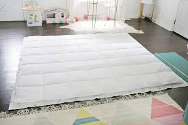 lay your comforter down on top of the sheets in your marked area to make sure that it will fit and then cut out your rectangle with scissors