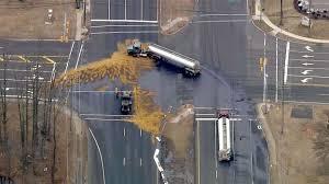 Major highway closed after tanker crash spills 6,000 gallons of fuel ...