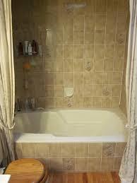 before brown stripes bathtub tile surround