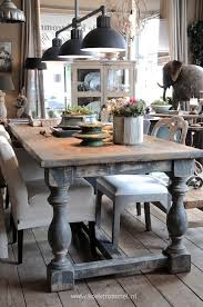 beautiful dining table made from salvaged wood and turned legs via koektrommel