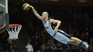 image of basketball player jumping for a dunk