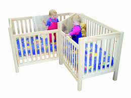 there are two diffe configurations of a great twin crib called a twin cot made by a company called pamco they offer the award winning corner cot for