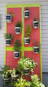 louvered bifold doors. Old Louvered Bifold Door. Some Paint. Galvaized Buckets. A Little Bracing. Hanging Doors