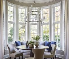 the dramatic ceiling height and cove moldings inspired the design of the breakfast room where parker gave a tiered chandelier from circa lighting pride of