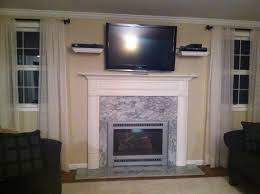 furniture modern idea of wall mounted tv shelves for your tv rh decorideas website fireplace with tv above designs tv mounted over fireplace brick