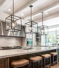 cube cage lighting complete with edison bulbs complements an oversized kitchen island