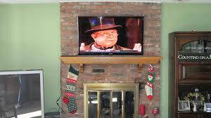 stone fireplace mounting plasma brick hang over where to put cable box traditional smlf