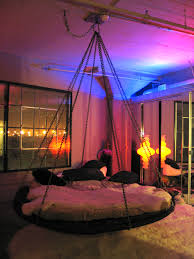Floating Round hanging bed with chains and fabulous lighting.