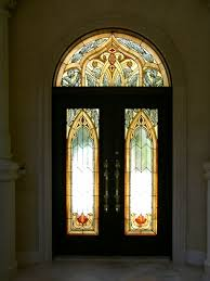 custom made stained glass entry doors and transom in a moorish style for this custom home