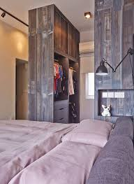the walk in wardrobe here is set perpendicular creating a shorter closet but resulting in a less restrictive bedroom