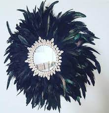 juju hat mirror feather wall decor