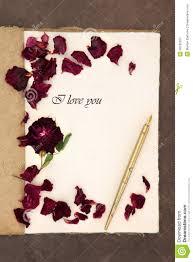 i love you letter old fashioned vintage hemp notebook phrase ink pen red rose petals over lokta paper background