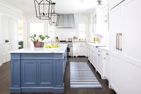 blue and white kitchen cabinets blue kitchen island with blue striped runner white kitchen cabinets with