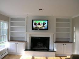 tv over fireplace. mounting tv over fireplace
