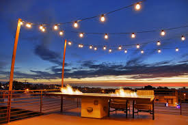 los angeles outdoor string lighting with concrete fire pits deck modern and metal beam patio table