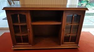 solid wood sideboard with glass door detail