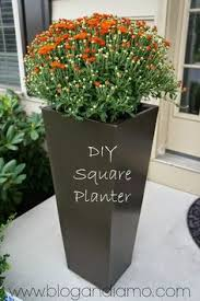 DIY Large Outdoor Planters For Cheap ~ Create large, lovely planters by  spray painting cheap plastic garbage cans. | Pinterest | Large outdoor  planters, ...