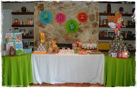 the round tables were set up to hold the take home favors a candyland game and a clear bucket to be filled with all of the candy