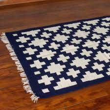 off white crosses on blue wool accent rug from peru 4x5 chakana geometry