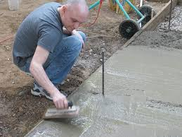 troweling the concrete slab or footing