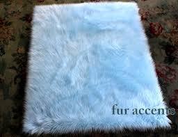 fur accents light blue faux fur area rug