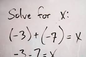 an algebraic equation is displayed on whiteboard