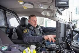 an albany police officer on patrol during the snow storm on march 2 2018