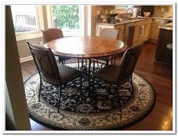 choosing rug for kitchen table editeestrela design braided rug under kitchen table