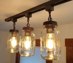 install a new mason jar track lighting and switch out your cur track lighting fixture youll