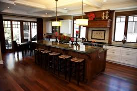traditional kitchen with two tier kitchen islands design ideas wooden pillar candle holders bulk and dark cherry wood flooring