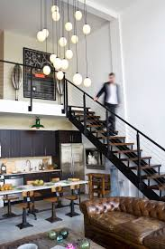 industrial loft lighting. modern loft living love the worn leather chesterfield contrast of cabinetry and white industrial lighting d