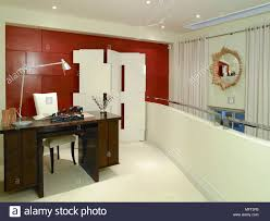 Loft home office Attic Modern Home Office Loft With Red Brick Wall Wooden Desk And Sculptural Folding Screen Alamy Modern Home Office Loft With Red Brick Wall Wooden Desk And