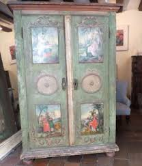 english antique armoire antique. Fabulous Swiss Armoire.Painted With Acanthus Scrolls,ribbon Tied Rossette Centred Roundels And Floral Pendants. The Four Raised Panels Depict Allegorical English Antique Armoire T