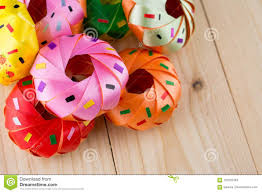 Coin Folding With Donut Ribbon On Wood Texture Stock Image