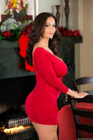 Ava Addams rides dick in her red dress and Santa hat Brazzers.
