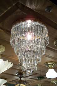 30s and 40s which are increasingly hung in bathrooms kastelberg says one popular lighting fixture is the wedding cake crystal chandelier
